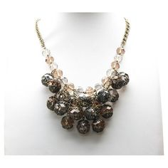 Chandelier necklace with cascading faceted glass jewels.   Product: NecklaceConstruction Material: Glass and me...
