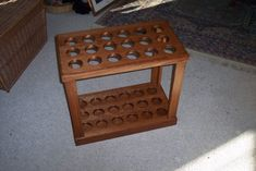 Another wooden fly rod tube rack.