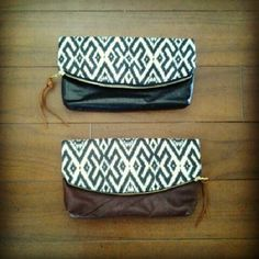 anne b: folded clutch with black vinyl - $45. maroon leather - $55