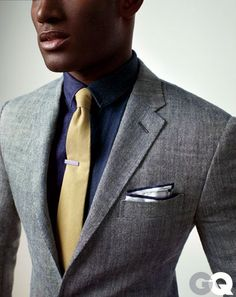 I like the combination of that blue underneath the grey; the yellow tie was the perfect touch. Thanks GQ.