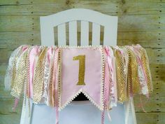 Are you having a pink and gold birthday party for your little ones first birthday? This pink and gold high chair tutu banner would be perfect while she celebrates her 1st birthday cake smash.