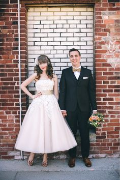 We love this bride's vintage-inspired tea-length gown and accessories!