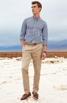 Shop this look on Lookastic:  http://lookastic.com/men/looks/navy-and-white-long-sleeve-shirt-tan-belt-khaki-chinos-dark-brown-boat-shoes/10435  — Navy and White Gingham Long Sleeve Shirt  — Tan Horizontal Striped Canvas Belt  — Khaki Chinos  — Dark Brown Leather Boat Shoes