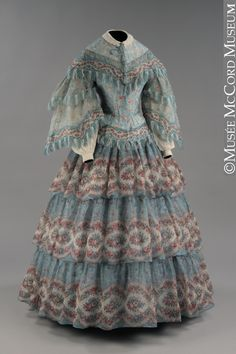 Wool mousseline de laine, cosy and covered up for cool weather, and great winter colours, circa 1855.