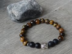 Grounded Wanderer bracelet by Wanderbird. Made with tiger's eye, onyx and buddha charm Black Onyx, Wander, Buddha, Beaded Bracelets, Trending Outfits, Eyes, Unique Jewelry, Handmade Gifts, Shop