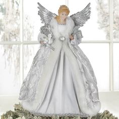 Top your tree with this beautiful angel, decked out in shimmering silver and fur-trimmed robes and glimmering silver wings. She is the perfect finishing touch to your pretty holiday tree. Christmas Tree Tops, Angel Christmas Tree Topper, Felt Christmas Ornaments, Holiday Tree, Christmas Pictures, Christmas Angels, White Christmas, Christmas Stuff, Christmas Decor