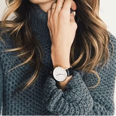 accessories with a black and white watch and gold rings.