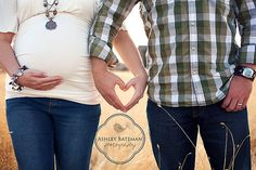 Sweet maternity photo - the heart hands could also be a save the date pose