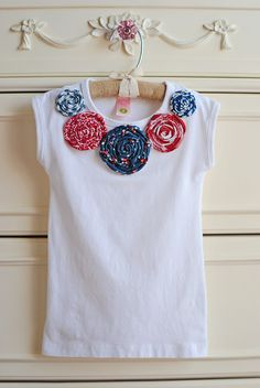 Cute shirt with rolled flowers