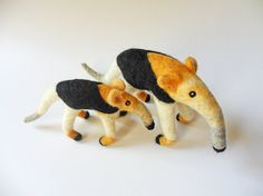 This baby tamandua or lesser anteater is made of wool by needle felting technique. This listing is only for one baby tamandua.  Dimensions: L: 12 cm. - 4,7 in. H: 5,5 cm. - 2,2 in. W: 4 cm. - 1,6 in You will receive what is pictured.   If you want tamandua family in 1. and 5. picture, you can look this link for mother tamandua: https://www.etsy.com/listing/213098931/lesser-anteater-needle-felted-animal?ref=shop_home_active_1   Keep in mind that colors of real item may look slightly different…