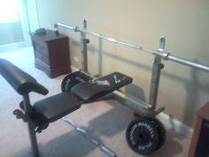 Total Sports America Weight Lifting Set in Hodoval's Garage Sale in Plainfield , IL for $100.00. This weight lifting bench is in great condition! Comes with bicep curling bar and bench pressing bar. ALso included is 2 45 lb weights, 2 35 lb weights, 2 25 lb weights, 2 10 lb weights, 2 5 lb weights, and 2 2.5 lb weights. Great value!