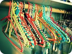 DIY Old Hangers Wrapped in Colorful Materials... I get these every Christmas from my great grandmother!!