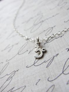 Astrology Sign Necklace by Olive Yew in silver, $20.