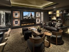 Traditional Home Theater with Standard height, sandstone floors, insert fireplace, Fireplace, Built-in bookshelf, can lights
