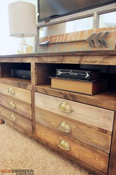How to build a DIY media console, designed to look like a printmaker's table. Opens shelving plus 3 spacious drawers gives plenty of storage.