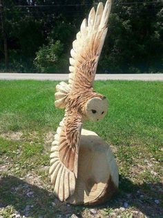 This is an owl carved from a tree stump! Amazingly real.