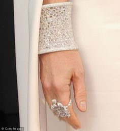 Gwyneth Paltrow drew our eye last night with this dazzling diamond encrusted cuff and bling bling flower ring! Love her.