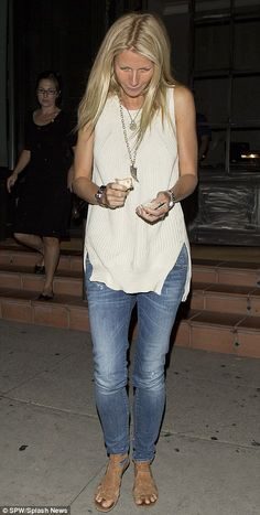 Love this casual look of knitted sleeveless top, fitted jeans and tan leather sandals sported by Gwyneth Paltrow.