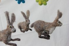 love these bunnies! and the needlefelt flowers are pretty too! Felted baby mobile hares dance by DaliaNerijusFelt on Etsy