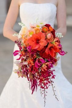 Breathtaking ombre orange and pink wedding bouquet: Photography: Sarah Maren - http://www.sarahmaren.com/