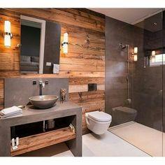 moderno e o rústico formando um banheiro maravilhoso