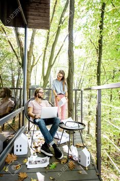 Creative couple of architects or designers working with house models and laptop on the balcony in the forest. Eco house projection concept Stock Photo , #AD, #working, #house, #models, #designers, #Creative