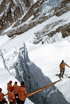 """Crevasse crossing on Everest 1963."" With the notable exception of Sir Edmund Hillary's successful summit of Mount Everest in May 1953, the peak had defeated nearly every other challenger. But the 1963 American Mount Everest Expedition, sponsored in part by the National Geographic Society, would prove the exception, placing the first Americans atop the mountain and pioneering a new route to the summit."
