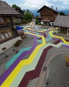 The streets of Vercorin, a small ski town in Switzerland, painted by Lang Baumann.