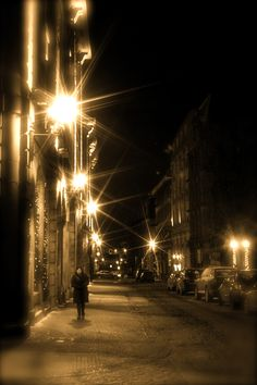 Winter stroll in Old Montreal. love this shot lonely person desolate walk sepia color photography photograph picture road sidewalk street light lighting