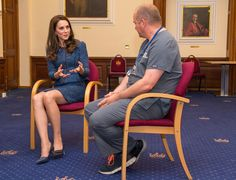 Kate Middleton Photos Photos - The Duchess of Cambridge speaks to Clinical Director and Consultant in Emergency Medicine Dr Malcolm Tunnicliff during a visit to Kings College Hospital in south London where she met staff and patients who were affected by the terrorist attacks in London Bridge and Borough Market, on June 12, 2017 in London, England. - Duchess of Cambridge Visits Kings College Hospital