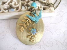Long Brass Locket necklace, vintage locket with verdigris bird and flower charms - by botanical bird via Etsy