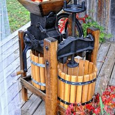 I'm soooo excited! I bought a cider press last weekend that will hopefully look like this when I restore it.  We will be pressing by next season!