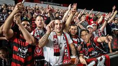 Loud and proud...Western Sydney Wanderers fans during last night's match against Sydney FC at Parramatta Stadium. Picture: Attila Szilvasi Source: The Daily Telegraph