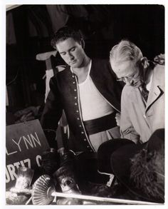 """Hollywood Movie Still - Errol Flynn in """"Captain Blood"""" Costume Check Photo by Bert Longworth Captain Blood, Errol Flynn, Olivia De Havilland, In Hollywood, Golden Age, Movie Stars, Candid, Handsome, The Incredibles"""
