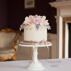 Pretty single tier wedding cake featuring spring flowers. By Ruby & Belle Cakes, Brighton, UK