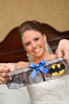 A superhero-themed garter makes for a fun surprise at the reception.- Luke would like the superman one instead