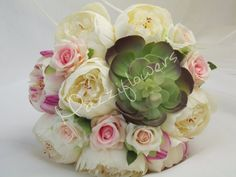Beautiful bouquet of flowers made of high quality satin, peony and rose flowers with flower rockery. The bouquet is in ivory and light pink, flower