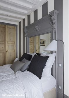 Our bedroom needs a makeover, big time! I'd love to do a greyscale colour palette like this one and I'm feeling that striped wall!