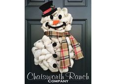 This is just to cute , and looks easy to do. Etsy listing at https://www.etsy.com/listing/249797993/the-original-snowman-wreath-christmas