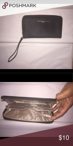 Adrienne Vittadini Wristlet/ Wallet A cute wristlet/ wallet. It does not have the charger with it. It is like new and perfect for carrying a few of the essentials. Adrienne Vittadini Bags Wallets