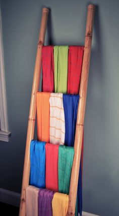 99141f2b422f Drape scarves over the bars of a ladder to create different looks. This  display is great for keeping merchandise in one concise area!