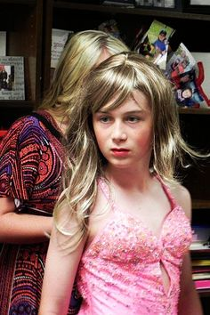 """Mom was so thrilled when I won the Womanless pageant at school that she decided  to make me her part-time daughter Eve. This is me, getting ready for my cousin Jill's """"School's Out"""" party. All of us girls are  wearing gowns and heels."""