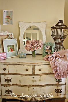 the distressed paint job on the dresser is terrific!