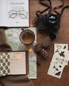 a few of my favorite things. hot freshly ground coffee. old dads camera. warm sweater. a book present from husband. vintage cards from a friend. pine cones collected in the wood. a map for future adventure. friday here you are. . what are the little things that made you happy today?  #littlefridaythings >>>>>>>>>>>>>>>>> мої маленькі радості. свіжозмелена кава. стара татова фотокамера. теплий светр. книга подарунок від чоловіка. вінтажні листівки від подруги. шишки з лісу. карта майбутньої…