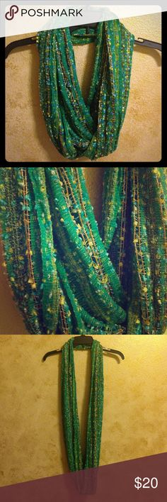 Gorgeous Infinity Scarf Gorgeous green infinity scarf with gold thread that runs through. Worn maybe once. Great condition. All my listings are always negotiable! Make any offer. See my SALE listing for details on free items or feel free to just ask me. Accessories Scarves & Wraps