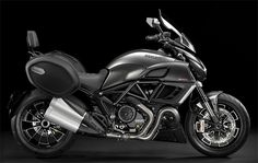 """2013 Ducati Diavel Strada :: The idea of a touring variant of the incredible Ducati Diavel superbike is like a Lamborghini station wagon or a Porsche SUV … Oh, wait. Well, anyway, before you write it off, consider what fun it would be to take this massive, 162 horsepower Italian stallion on a roadtrip. The """"Strada"""" features everything you need for touring: a windshield, panniers, even a passenger backrest."""