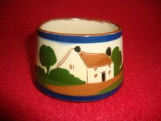 """Torquay Motto Cottage Ware Watcombe Pottery Sugar Bowl: Produced by the Watcombe Pottery in the early part of the 20th century , the bowl features a cottage decoration to the body and the words """"Ave some sugar m` dear"""" . The piece is fully marked to the base. Dimensions: 4.5 cm high x 8 cm wide (at the widest point) - Condition: Excellent - Stock Number: B020 - Price: SOLD"""