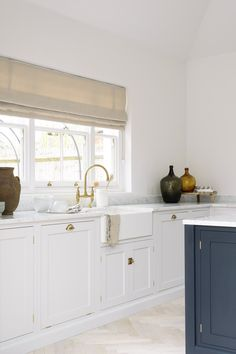 The cool and contemporary Coach House Kitchen by deVOL feels fresh and modern with wonderfully soft blue grey cupboards and brass details.