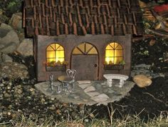 Miniature lighted fairy house casts a warm glow Yellow cellophane in the windows Small bulbs inside. Solar Fairy House, Fairy Garden Houses, Fairy Gardening, Miniature Trees, Miniature Fairy Gardens, Garden Terrarium, Terrariums, House Cast, Fairy Tree