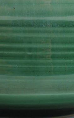 FetishGhost's Secret Studio: Cone 6 Oribe Green32% Custer Feldspar 24% Whiting 24% Silica 12% EPK 8% Zinc Oxide add 5% Copper carbonate Cone 5-7 (ClayTimes May/ June 02, Pg. 59) This is a beautiful transparent glossy Jade green glaze. Plan for a bit of vertical movement with this glaze, especially if applied thick. Prone to pin-holing is not soaked at the top of firing. It works very well over a black slip design.
